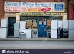 second-hand-shop-with-used-goods-displayed-outside-the-entrance-FHTFTB.jpg